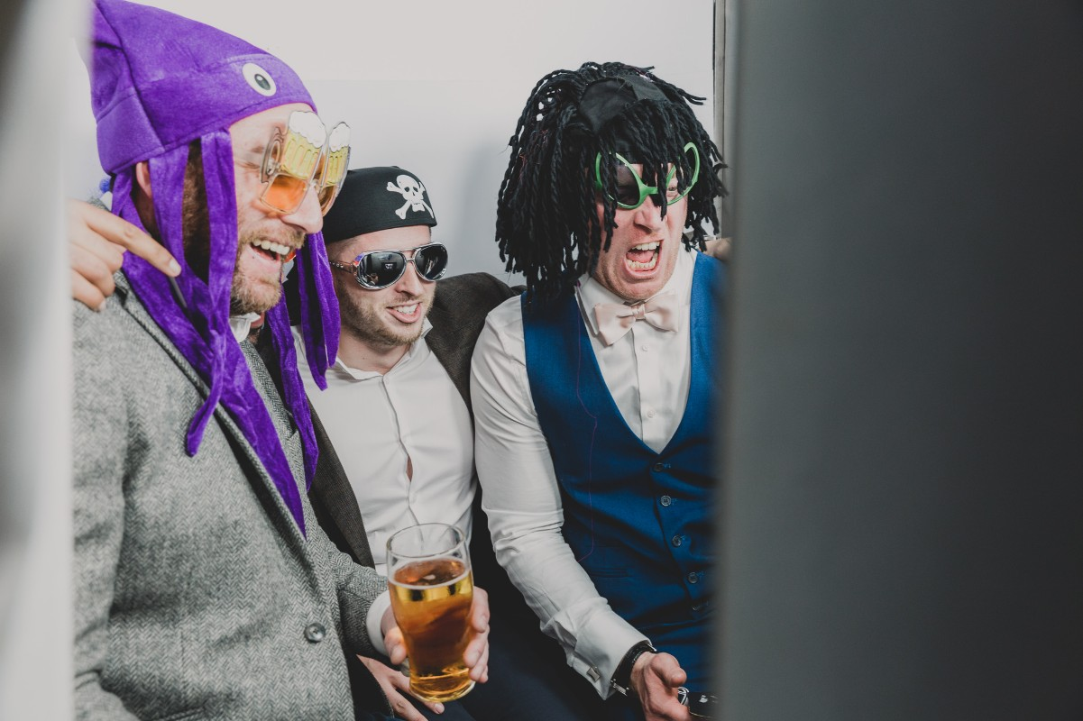 3 men enjoying the photo booth